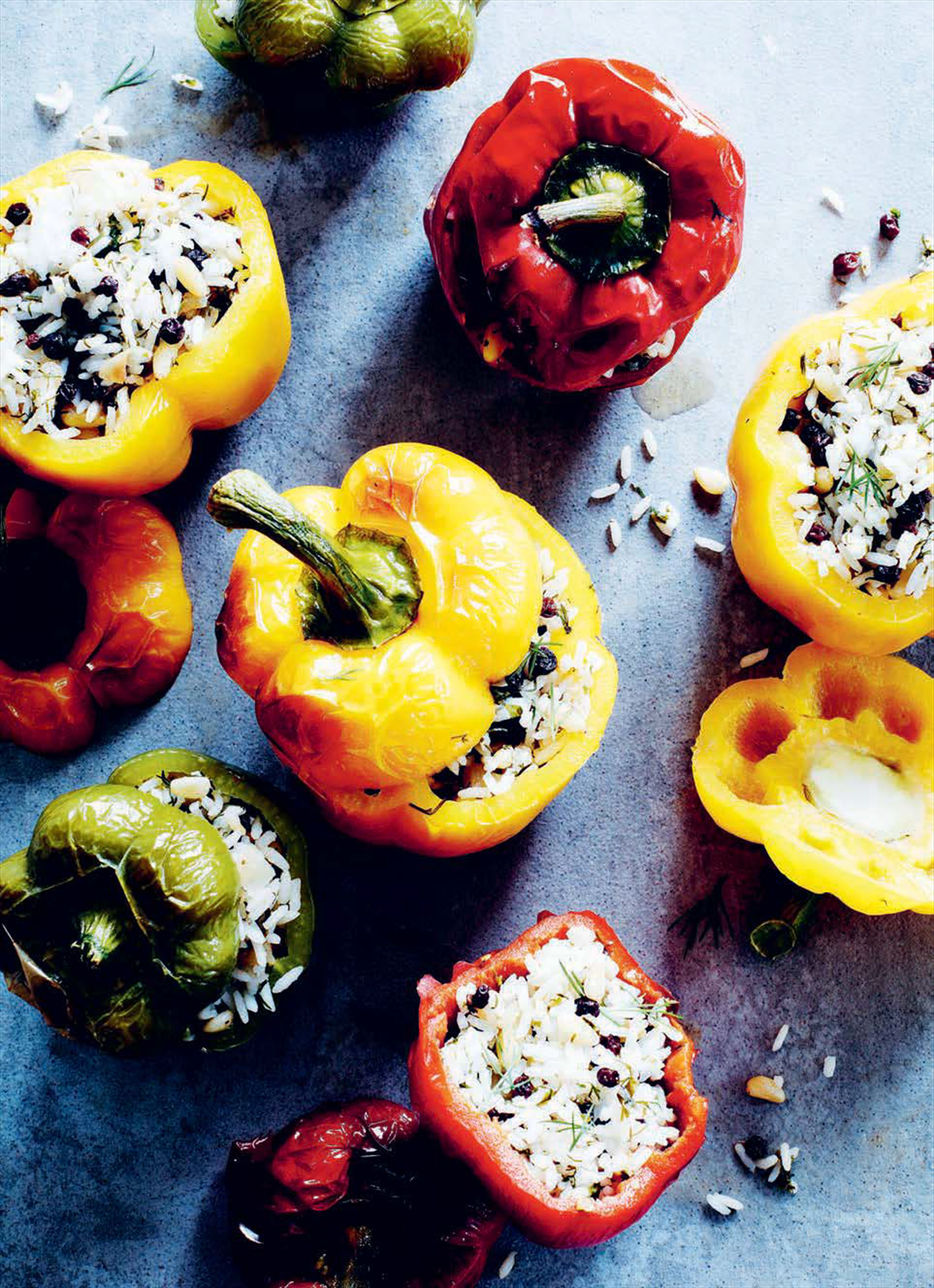 Sweet peppers stuffed with rice, pine nuts and currants