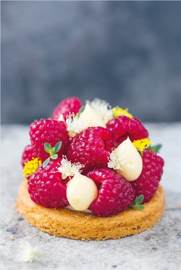 Raspberry and goat's milk tarts with lemon myrtle cream