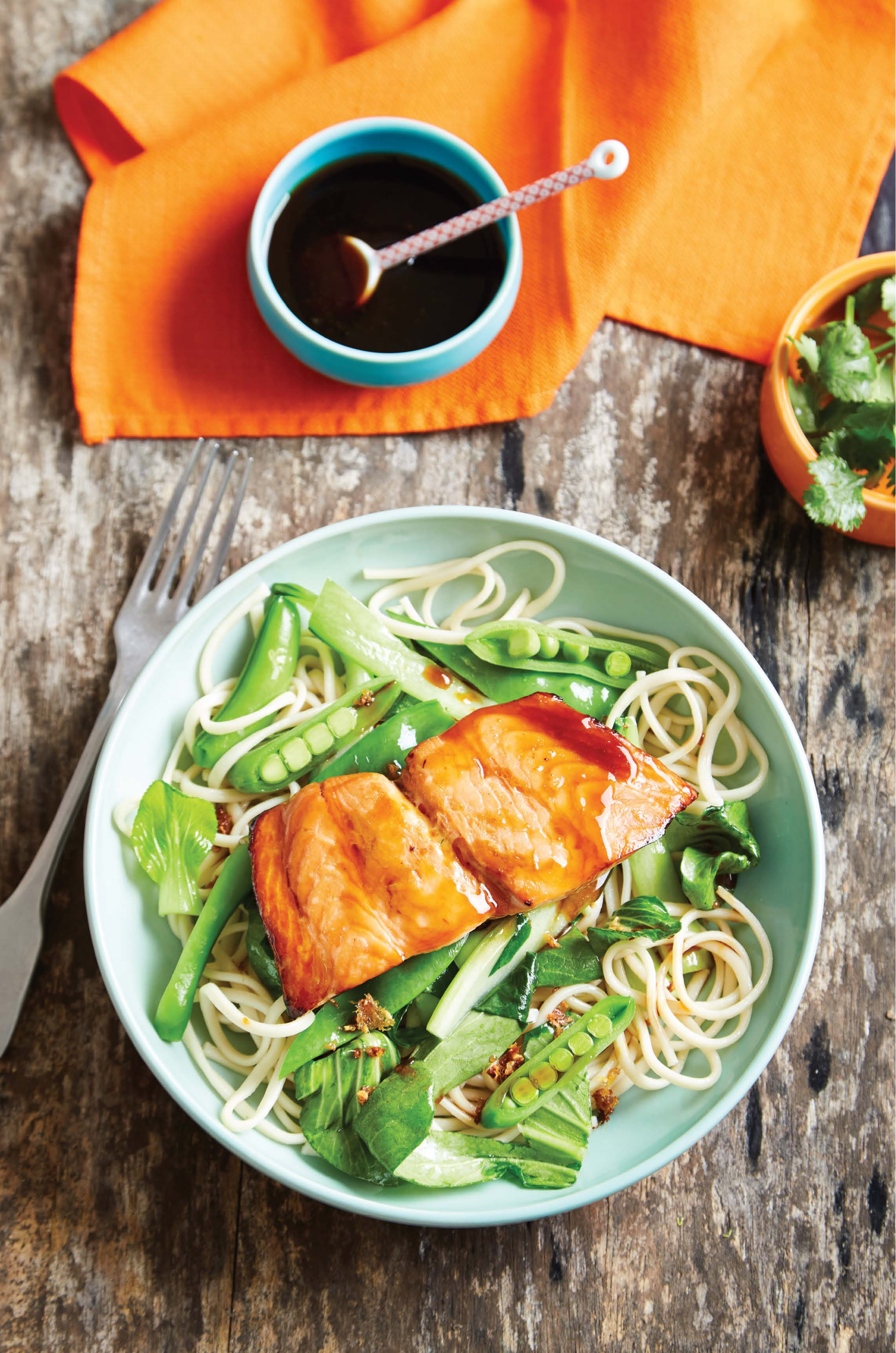 Teriyaki salmon with udon noodles and stir‑fried vegetables