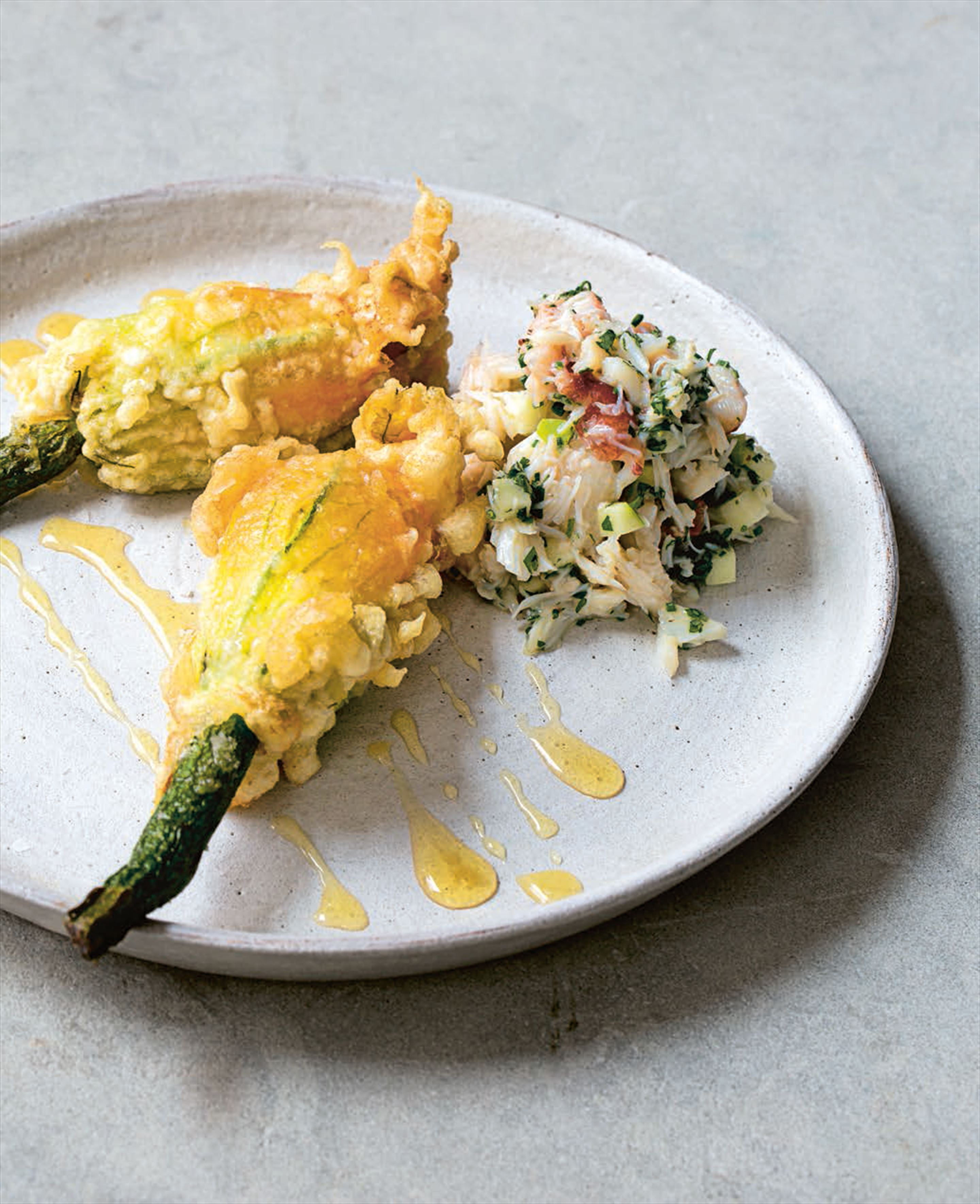 Goat's-cheese-stuffed courgette flowers with apple and coriander crab salad