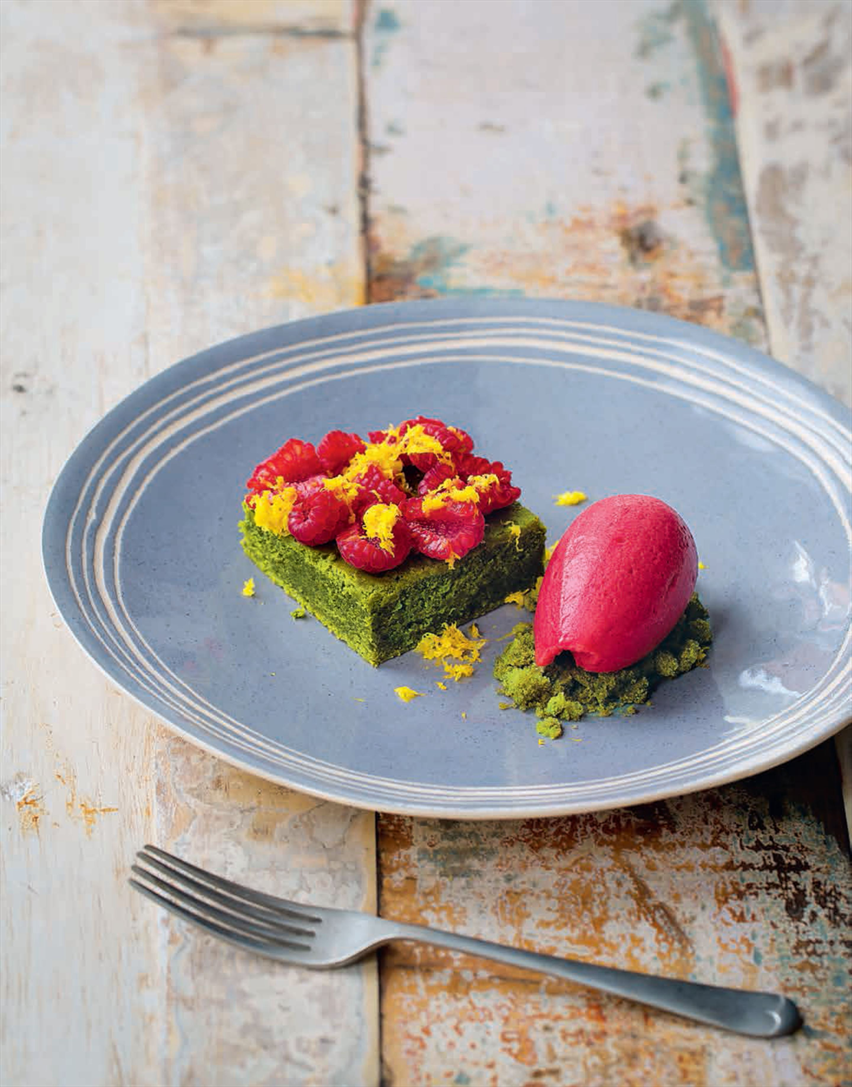 Green tea cake, yuzu and raspberries