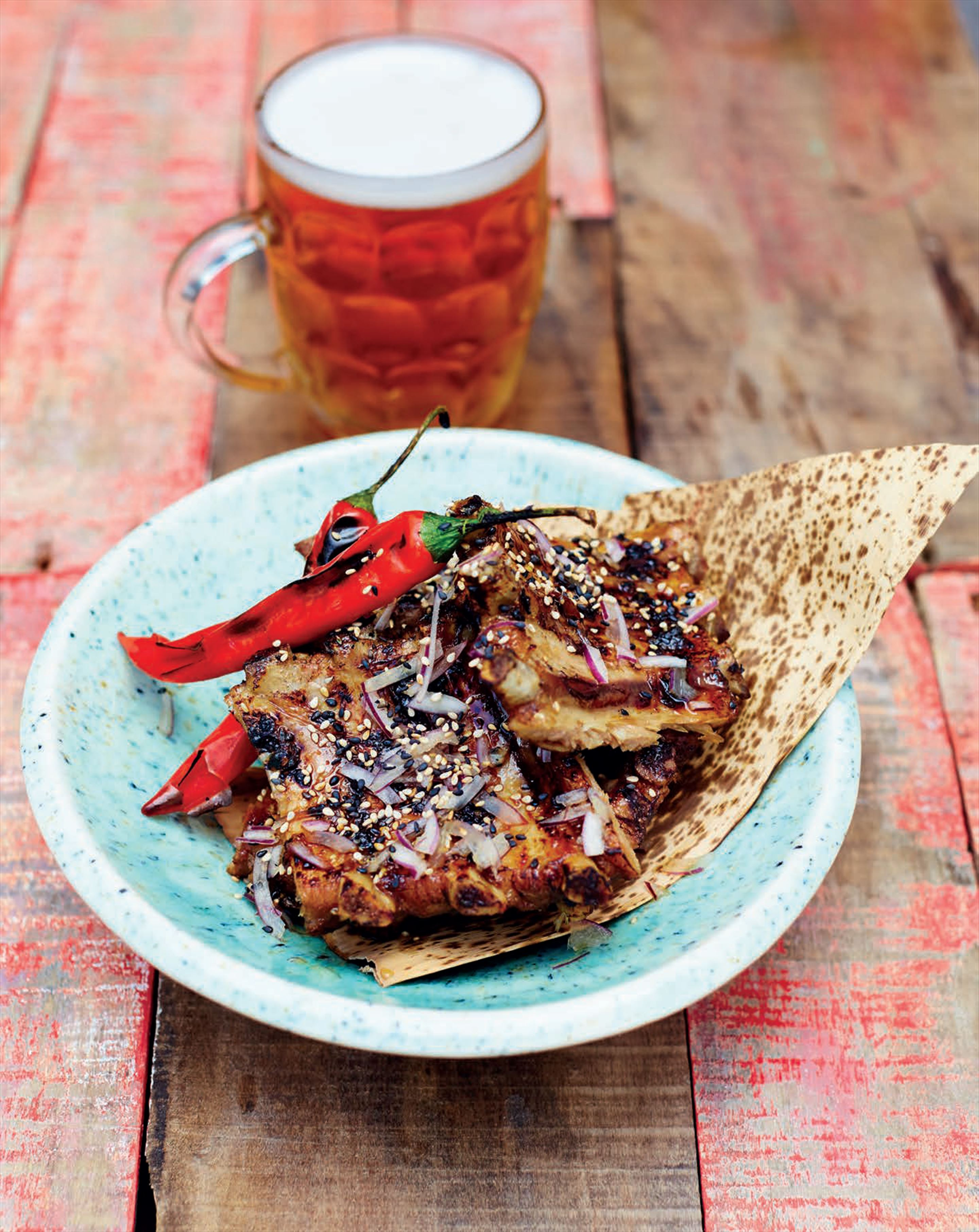 Barbecued pork ribs with sticky honey, soy and ginger glaze