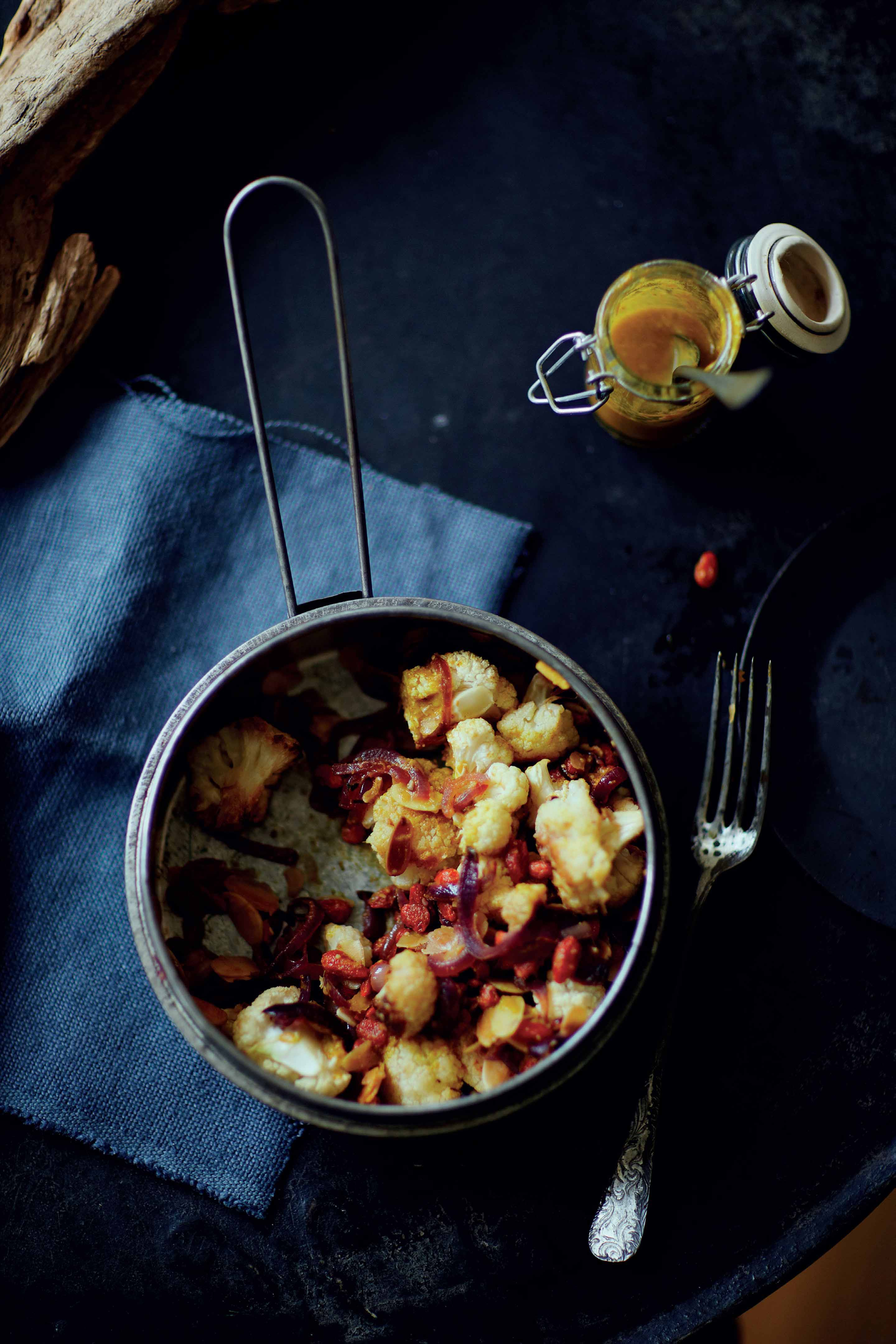 Cauliflower, goji berry and almond salad with turmeric dressing