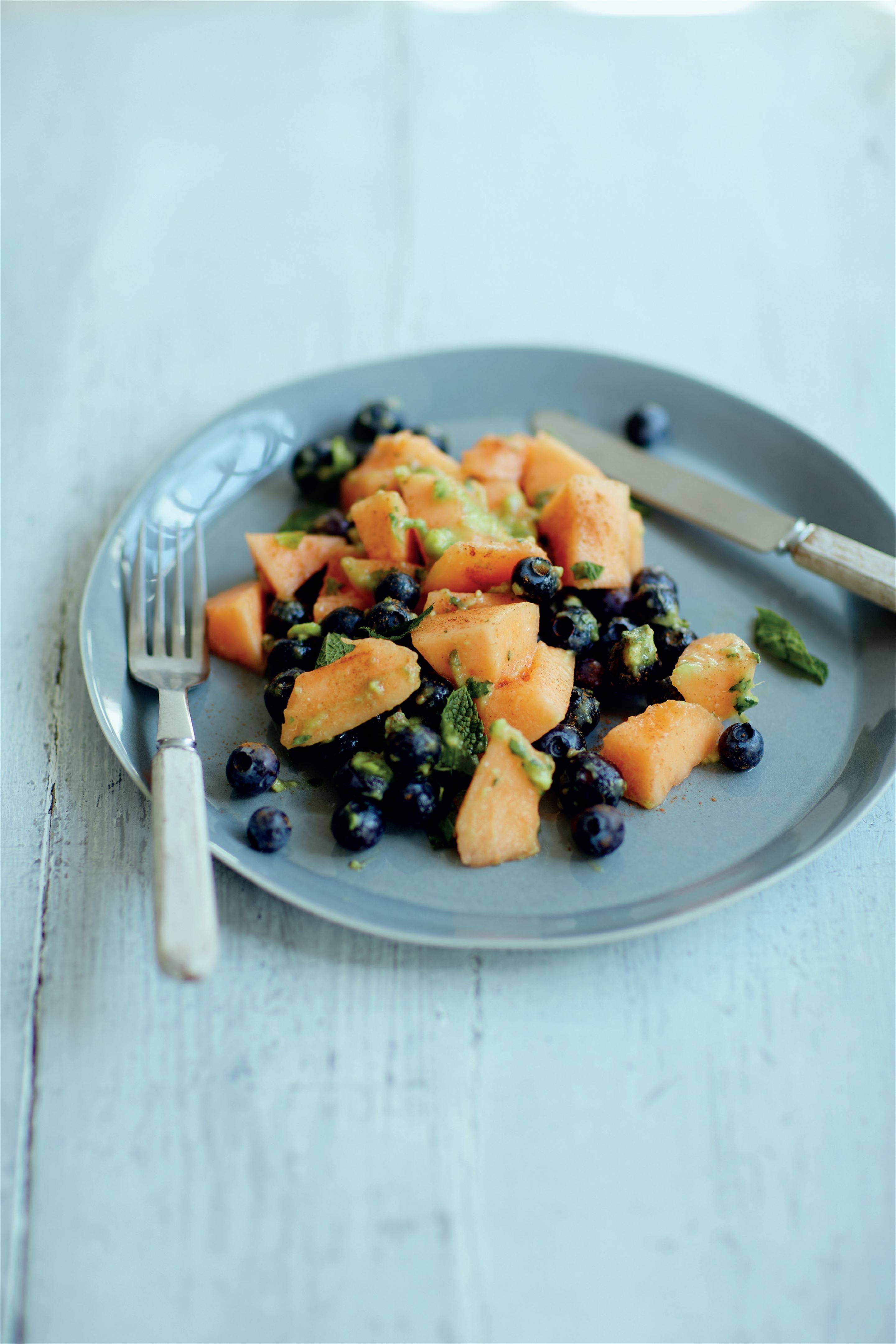 Cantaloupe melon and blueberry salad with avocado lime dressing