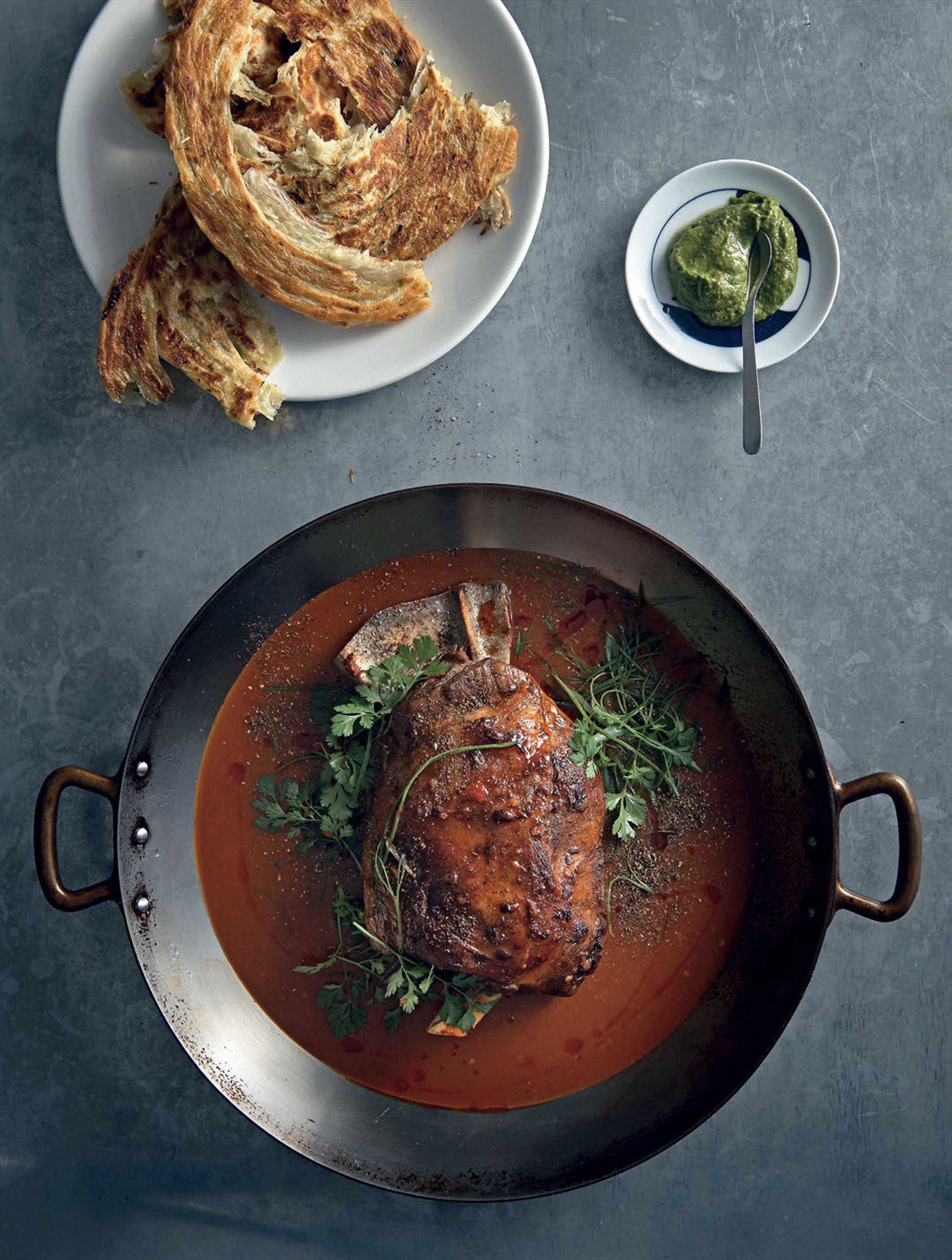 Whole roast lamb shoulder, coriander and mint paste, sichuan sauce