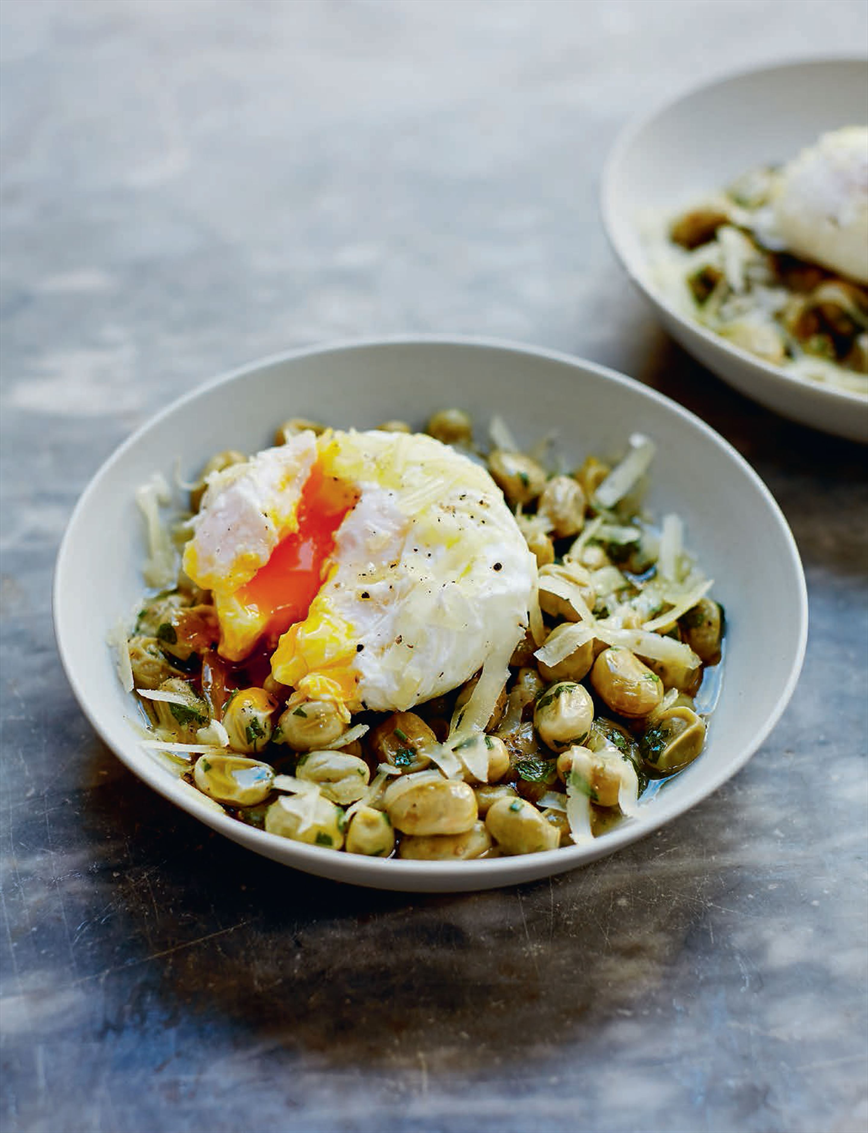 Slow-cooked broad beans with poached egg