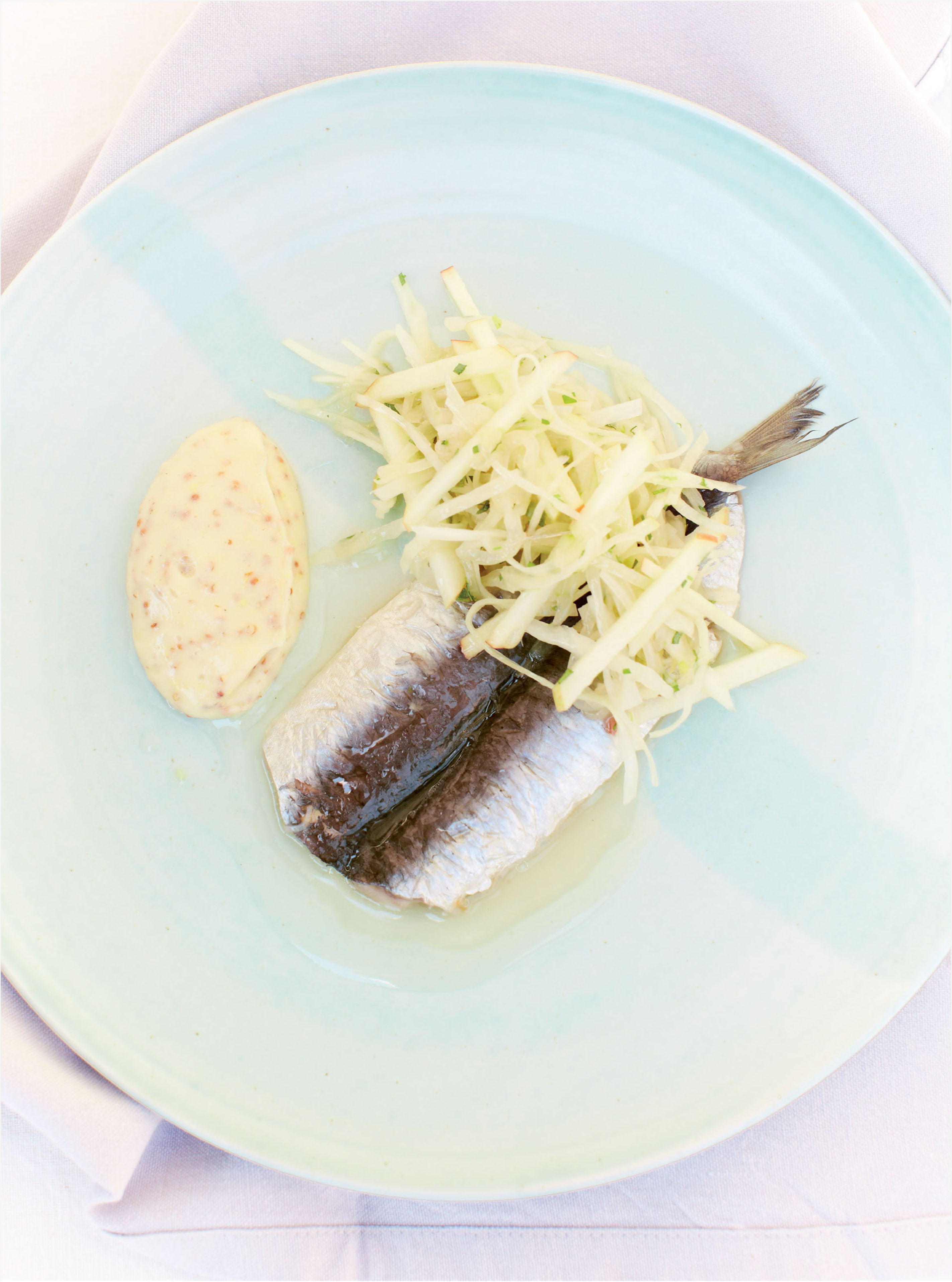 Soused sardines with white cabbage and mustard