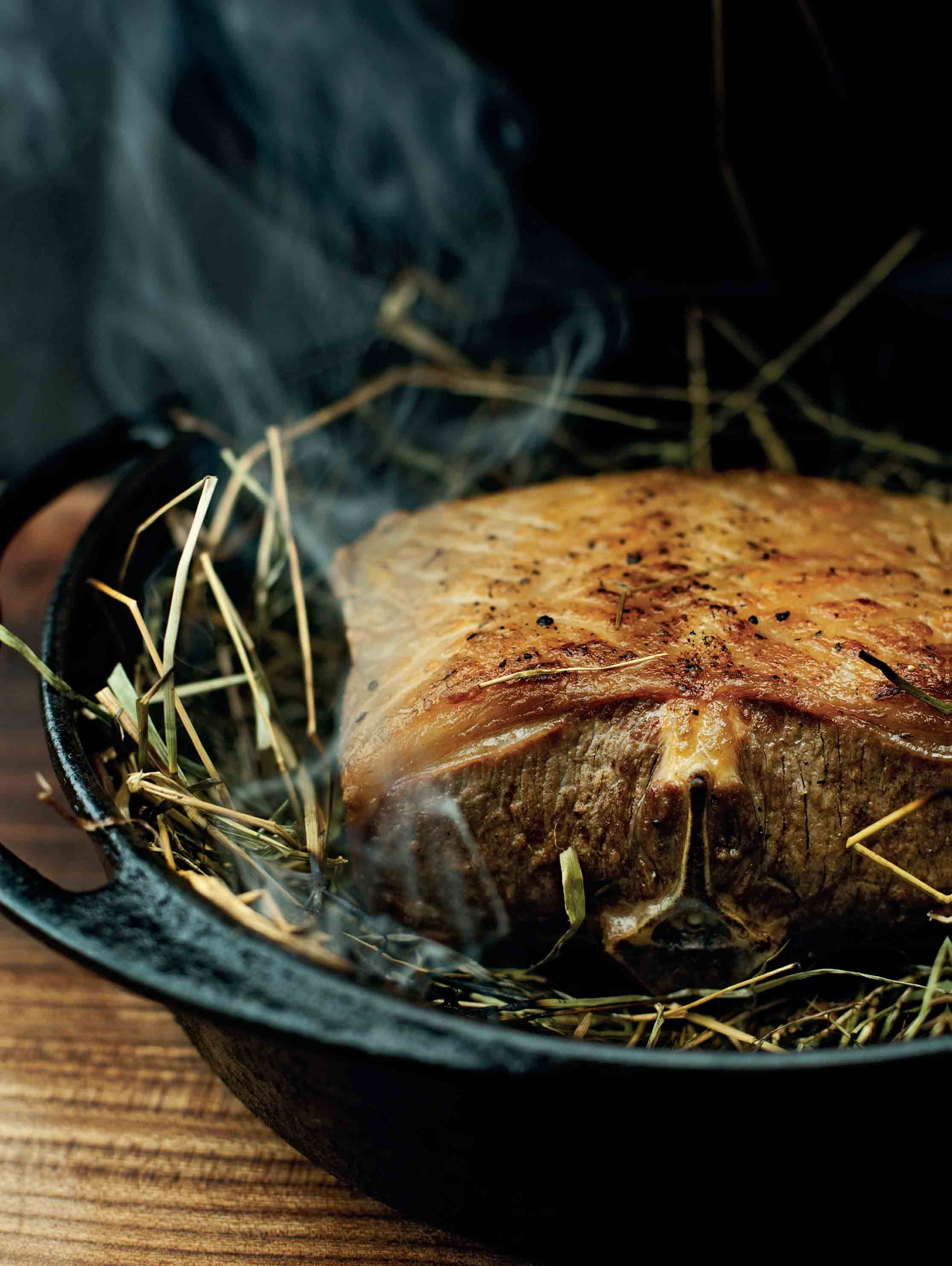 Saddle of lamb cooked on hay with boulangère potatoes