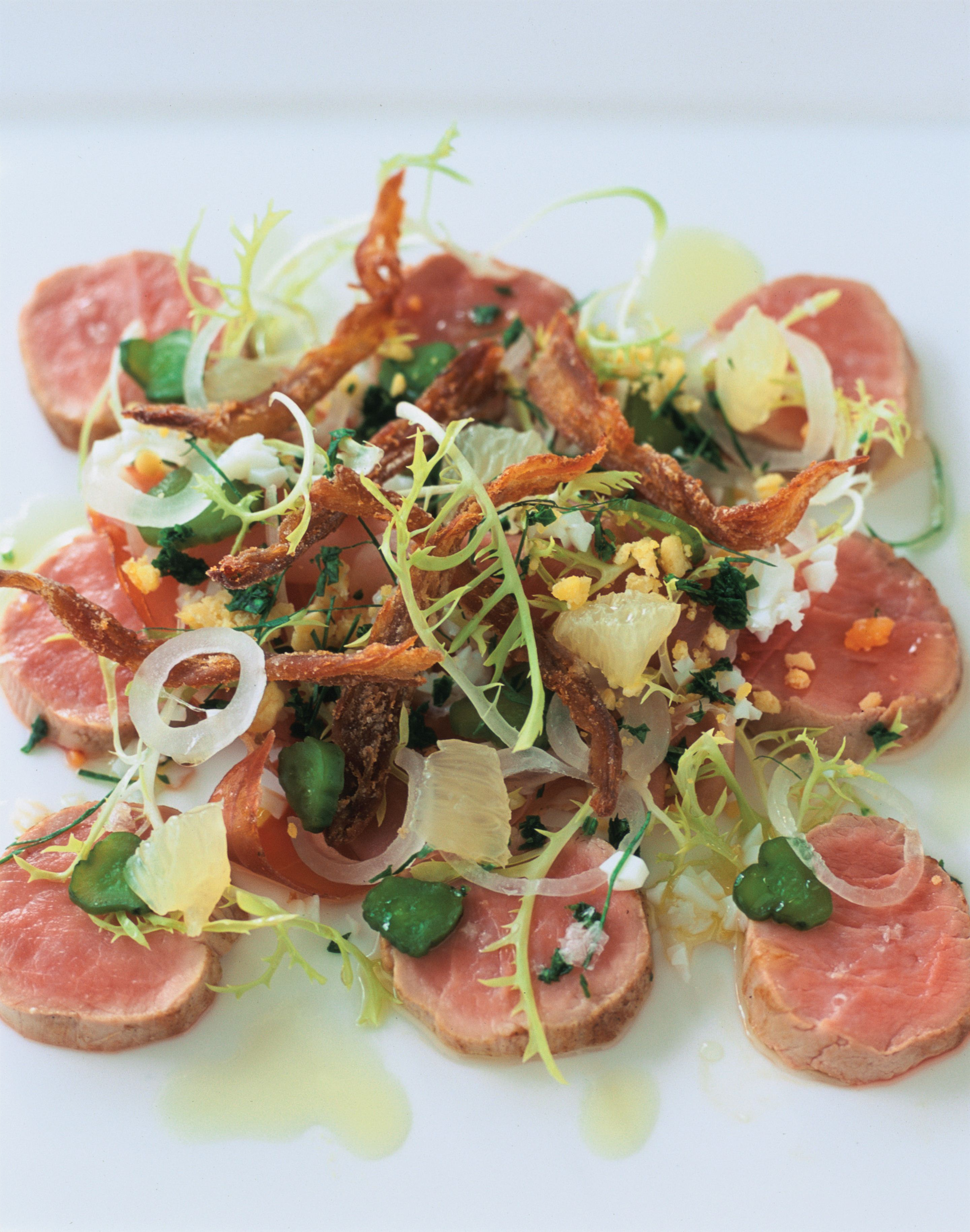 Slow-poached fillet of pork with gribiche vinaigrette and crisp pig's tail