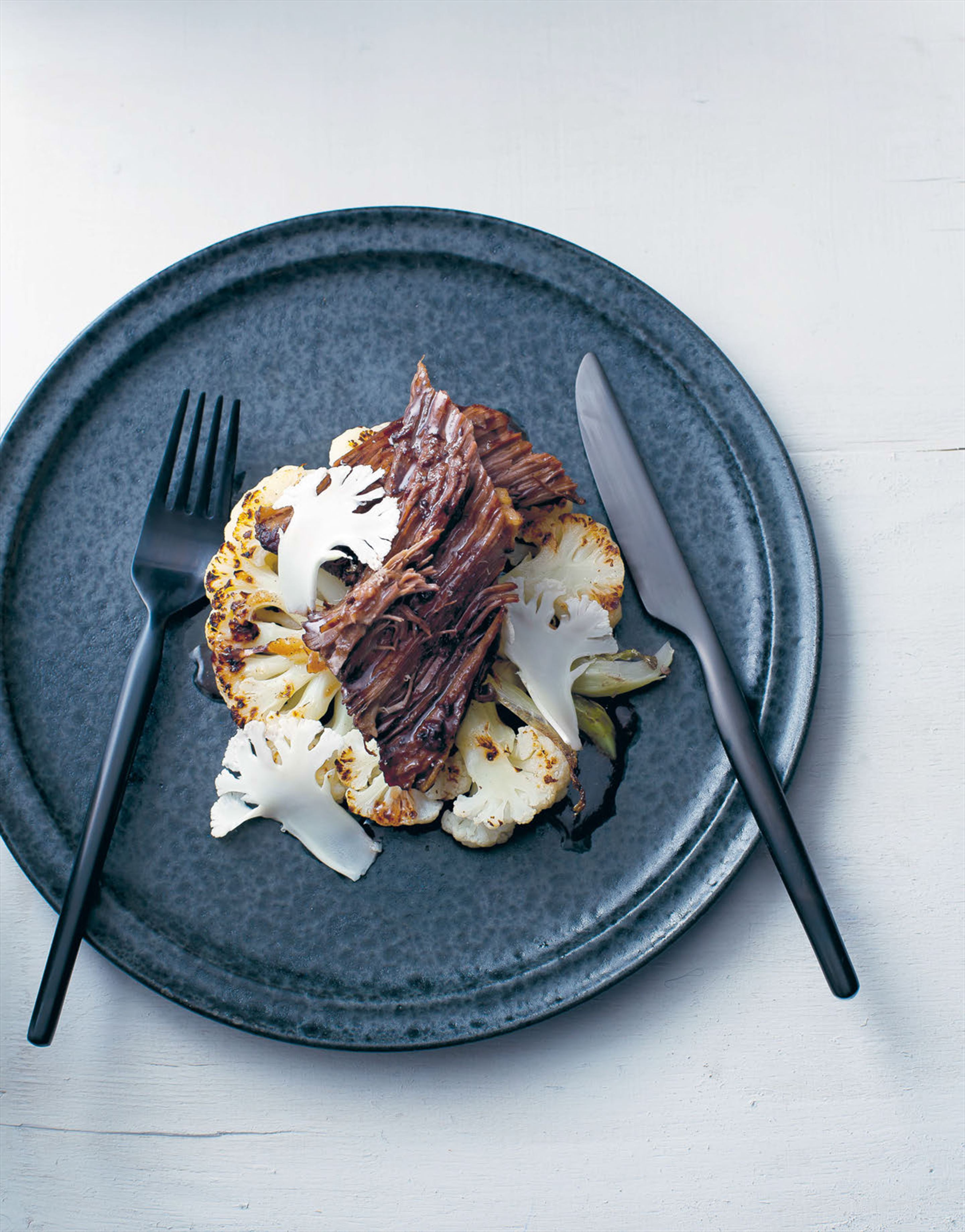 Beef brisket, spiced wine & cauliflower steaks