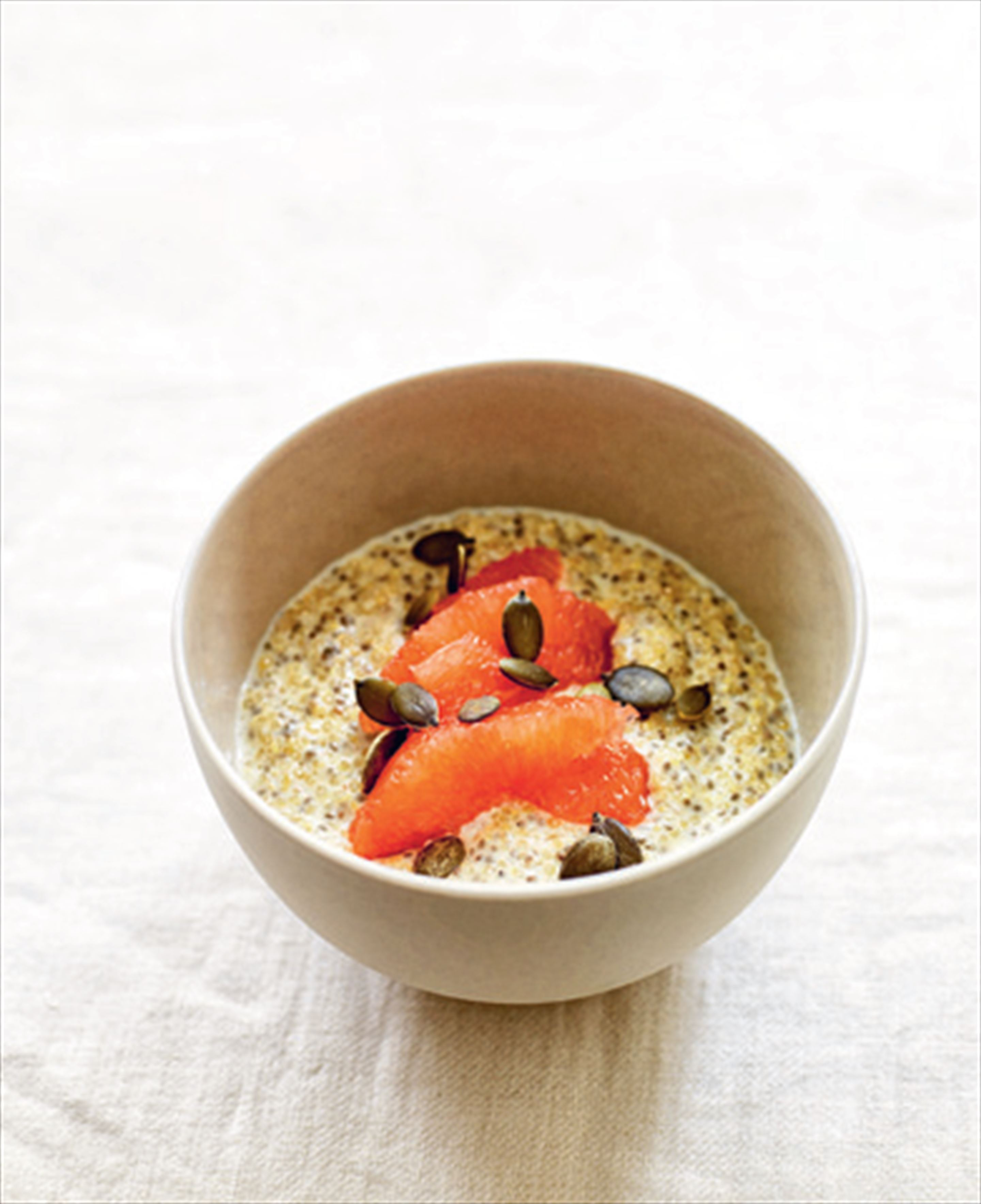 Quinoa porridge with pink grapefruit, pumpkin seeds & chia seeds