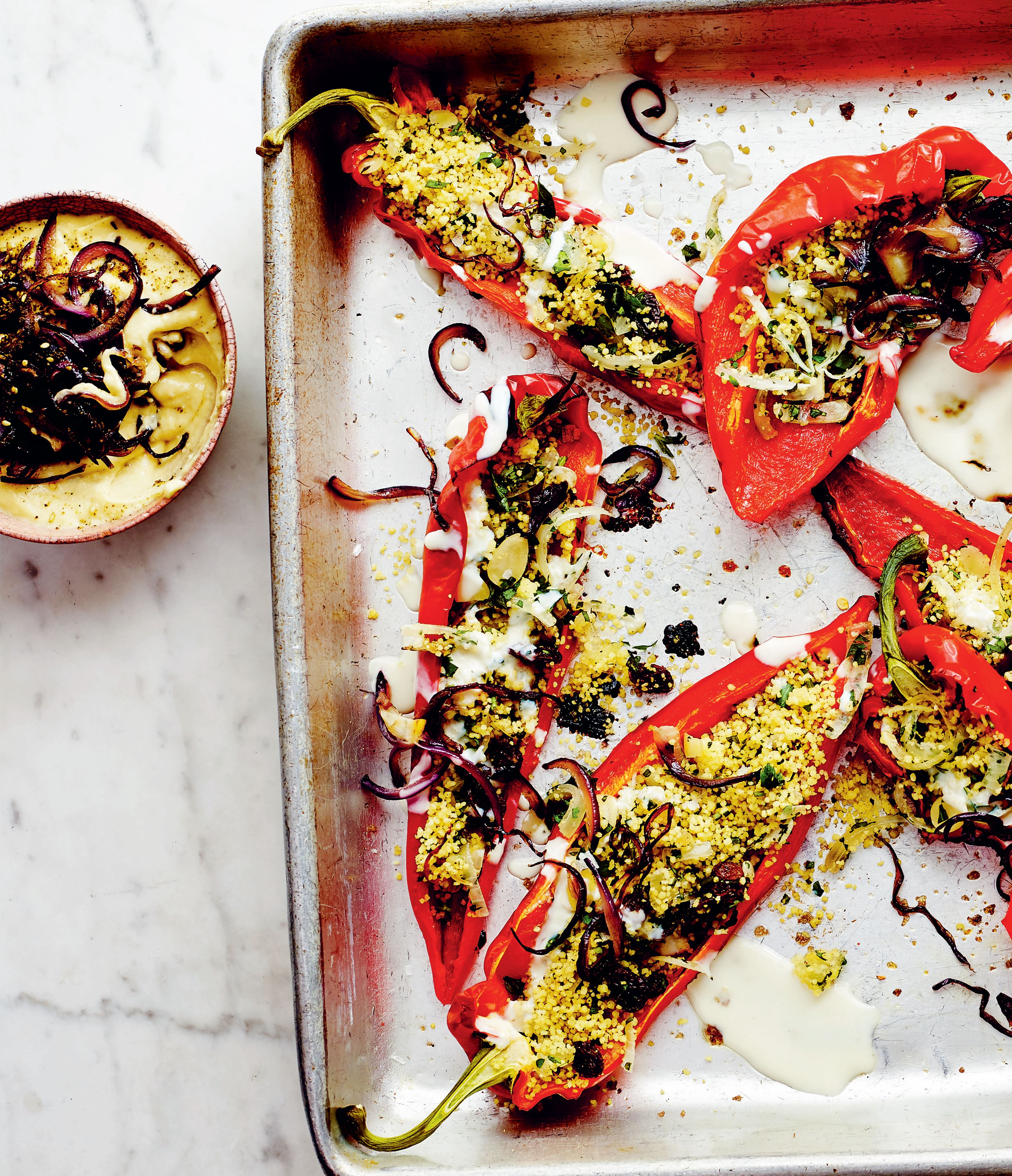 Sweet-stuffed ramiro peppers with salted lemon yoghurt