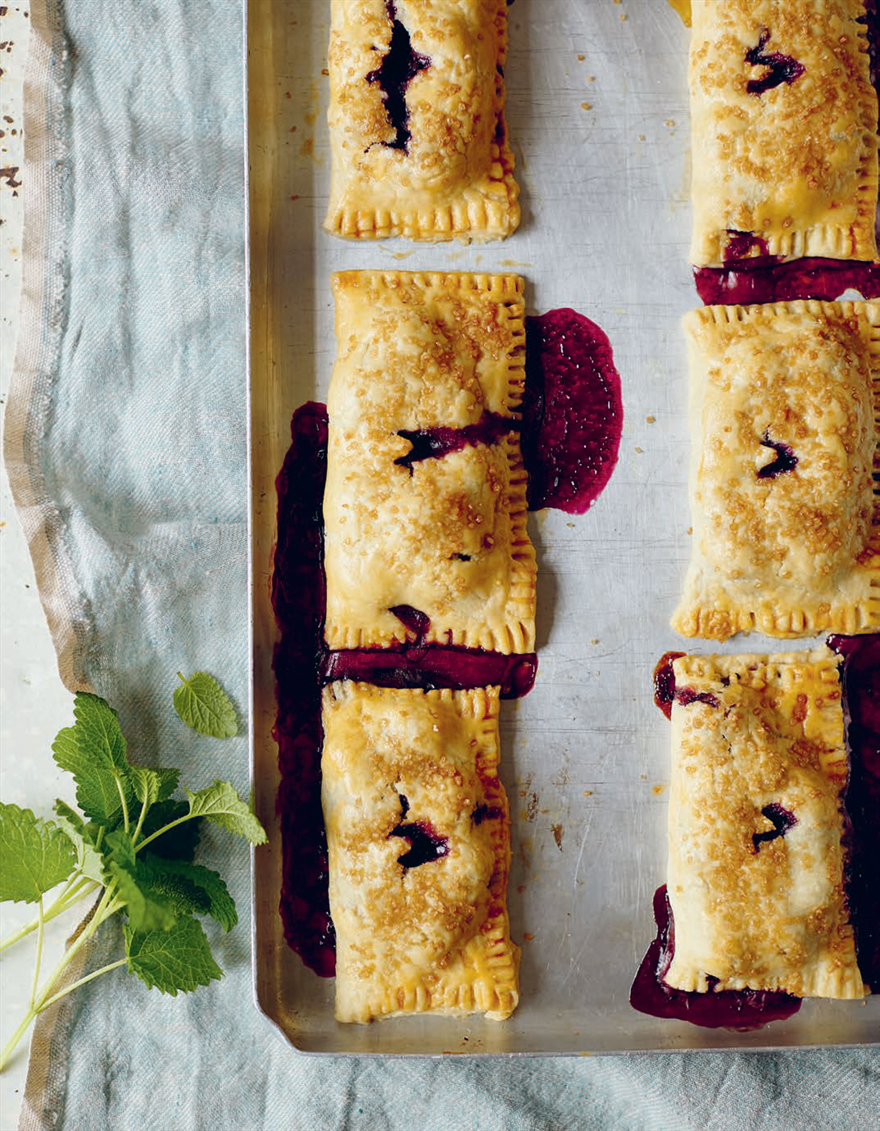 Blueberry hand pies with demerara sugar & lemon balm