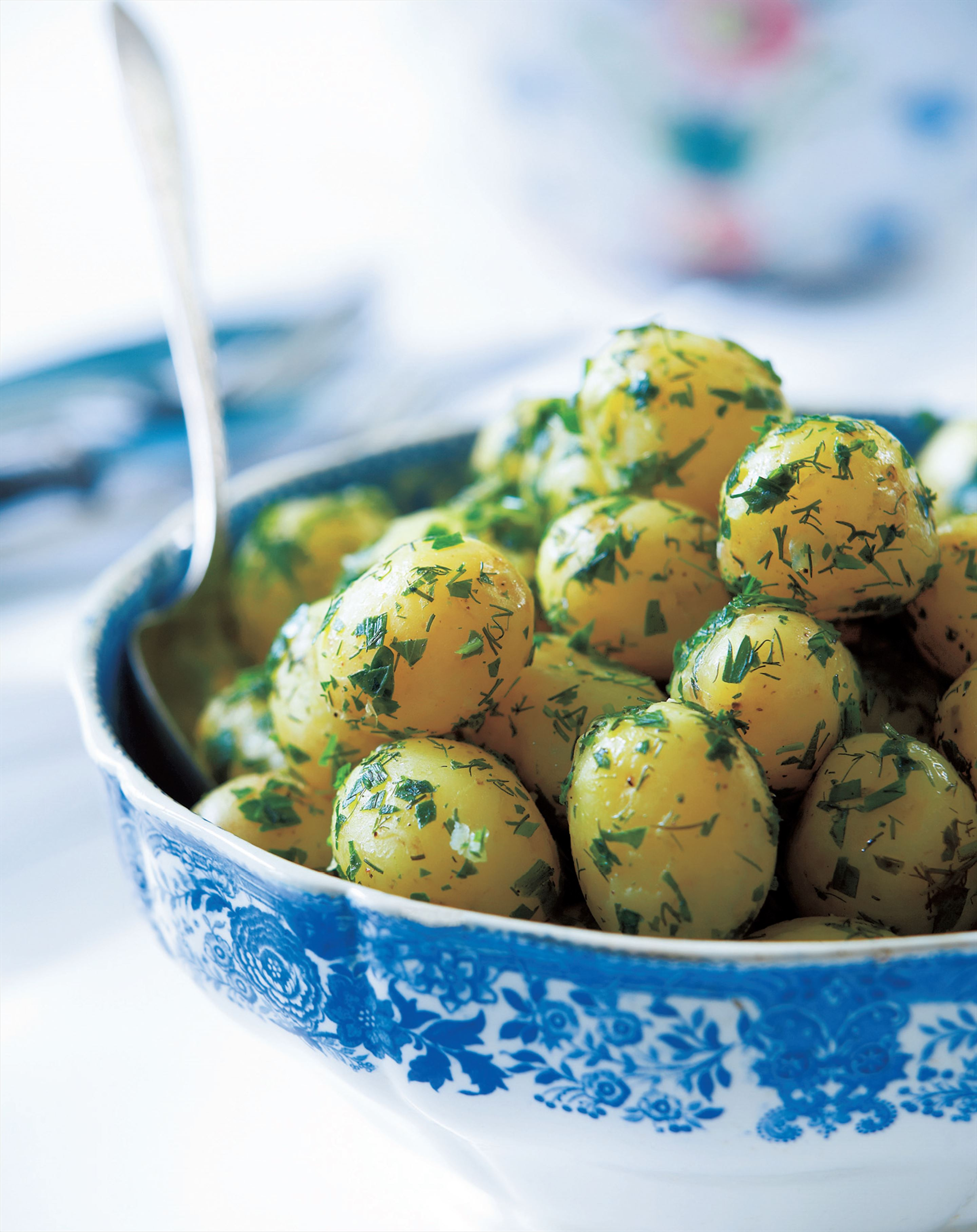 Potato salad with fresh herbs and spring onions
