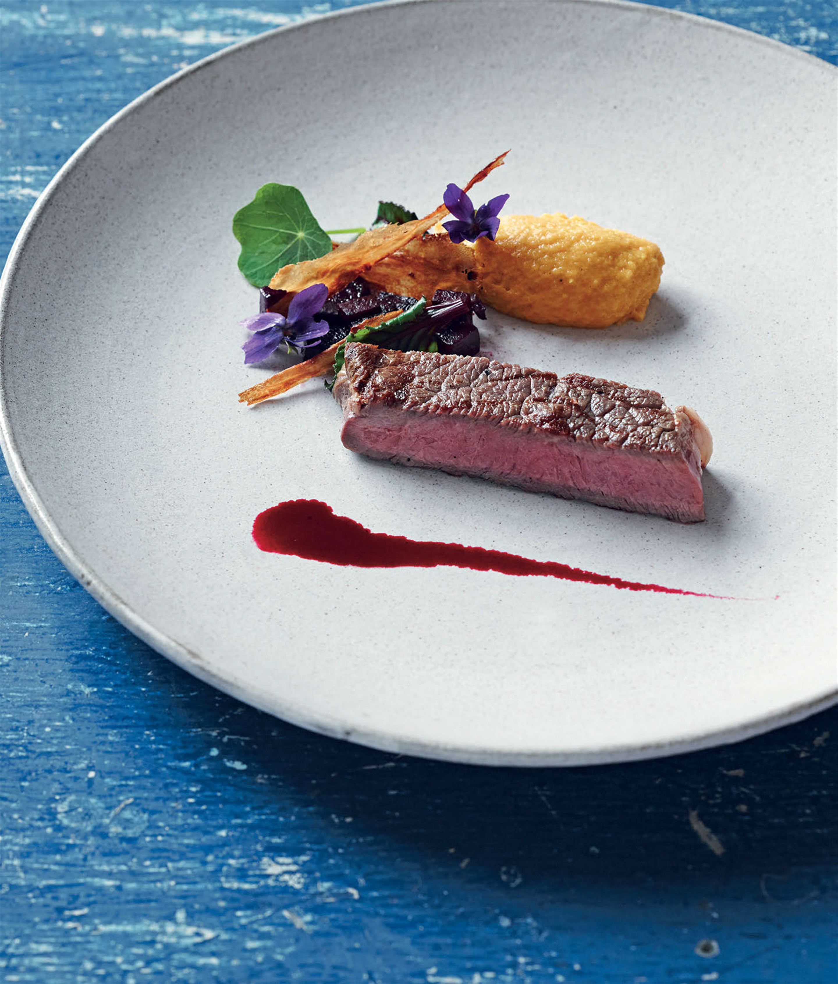 Roasted rib eye with beetroot and parsnip